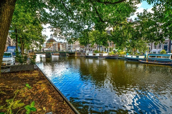 Imagine this canal in Amsterdam, with a number of boats acting as an improvised bridge in times of high traffic.