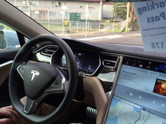 A Tesla car operating in Autopilot mode, where the car is driving itself- instead of being driven by the person inside or an unseen hacker. (Source: Marc van der Chijs.)