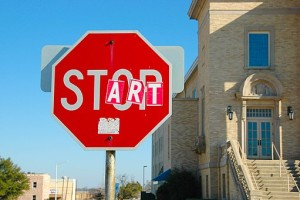 512px-Vandalized_stop_sign_-_start_and_stop (1)