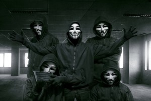 Group of hooded hacker with mask standing